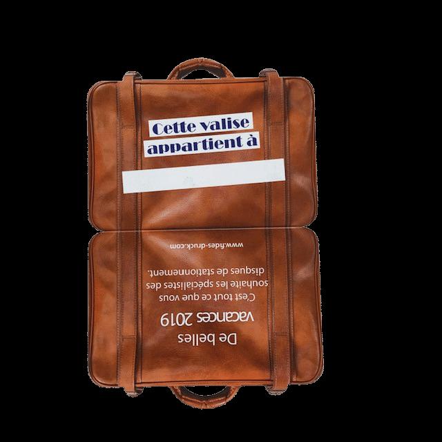 Etiquette bagage en forme de valise